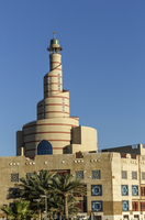 Islamic Cultural Center spire under blue sky, Doha, Qatar