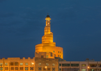 Islamic Cultural Center spire illuminated at night, Doha, Qatar