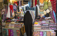 Woman shopping in fabric market