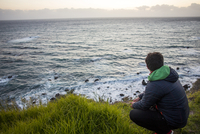 Caucasian man admiring ocean horizon