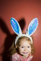 Caucasian baby girl wearing bunny ears