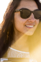 Mixed race woman wearing sunglasses