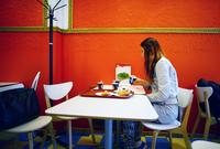 Caucasian woman eating in restaurant