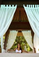Pacific Islander woman sitting in cabana