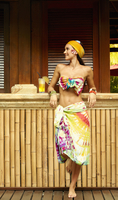 Pacific Islander woman standing at outdoor bar