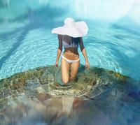 Pacific Islander woman walking in swimming pool