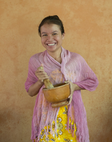 Khmer woman using mortar and pestle