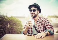Hispanic man drinking coffee outdoors