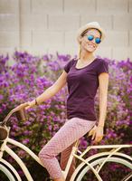 Hispanic woman riding bicycle