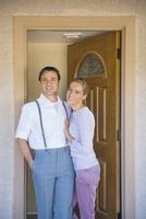 Hispanic couple smiling in doorway