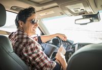 Hispanic couple driving car
