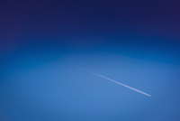 Airplane trail in blue sky