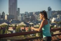 Caucasian woman admiring Portland cityscape, Oregon, United States