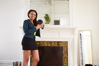 African American woman smiling near fireplace