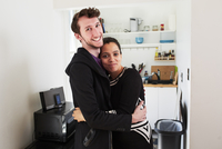 Couple hugging in kitchen