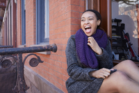 African American woman laughing in window
