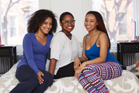 Women smiling on bed