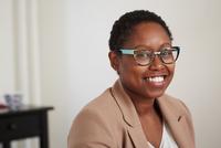 Black woman smiling indoors