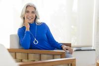 Caucasian woman smiling in armchair