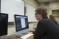Student using computer in classroom