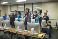 Students reciting Pledge of Allegiance in classroom