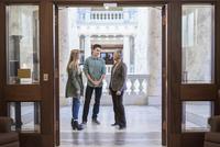 Caucasian family taking tour of capitol