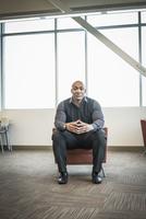 Black businessman sitting in office lounge