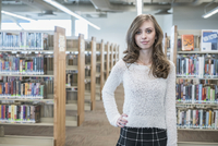 Woman standing in library