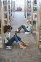 Students reading books in library