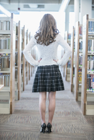 Student standing in library