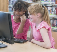 Students using computer in library