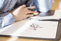 Caucasian businessman doodling in office