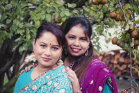 Women wearing traditional Indian dresses in garden