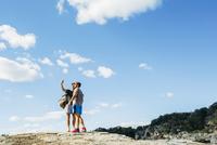 Caucasian friends taking selfie on hilltop
