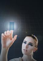 Caucasian woman using holographic touch screen 11018072945| 写真素材・ストックフォト・画像・イラスト素材|アマナイメージズ