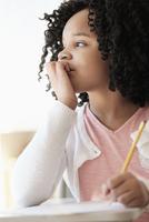 African American student writing in classroom 11018073036  写真素材・ストックフォト・画像・イラスト素材 アマナイメージズ