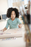 African American girl painting with watercolors