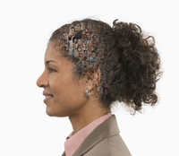 Profile of businesswoman with collage of faces in hair