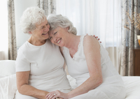 Older Caucasian lesbian couple hugging