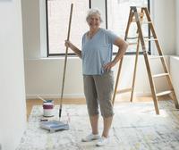 Older Caucasian woman renovating new house