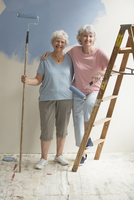 Older Caucasian lesbian couple renovating new house