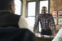 African American businessmen talking in office