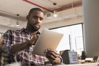 African American businessman using digital tablet in office