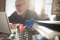 Hispanic businessman using laptop in office