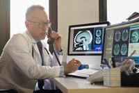 Asian doctor examining x-rays