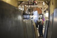 Caucasian worker standing in workshop
