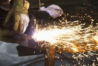 Caucasian worker welding in workshop