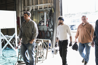 Workers walking in workshop