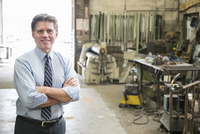 Caucasian businessman standing in workshop