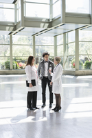 Doctors and businessman talking in empty office